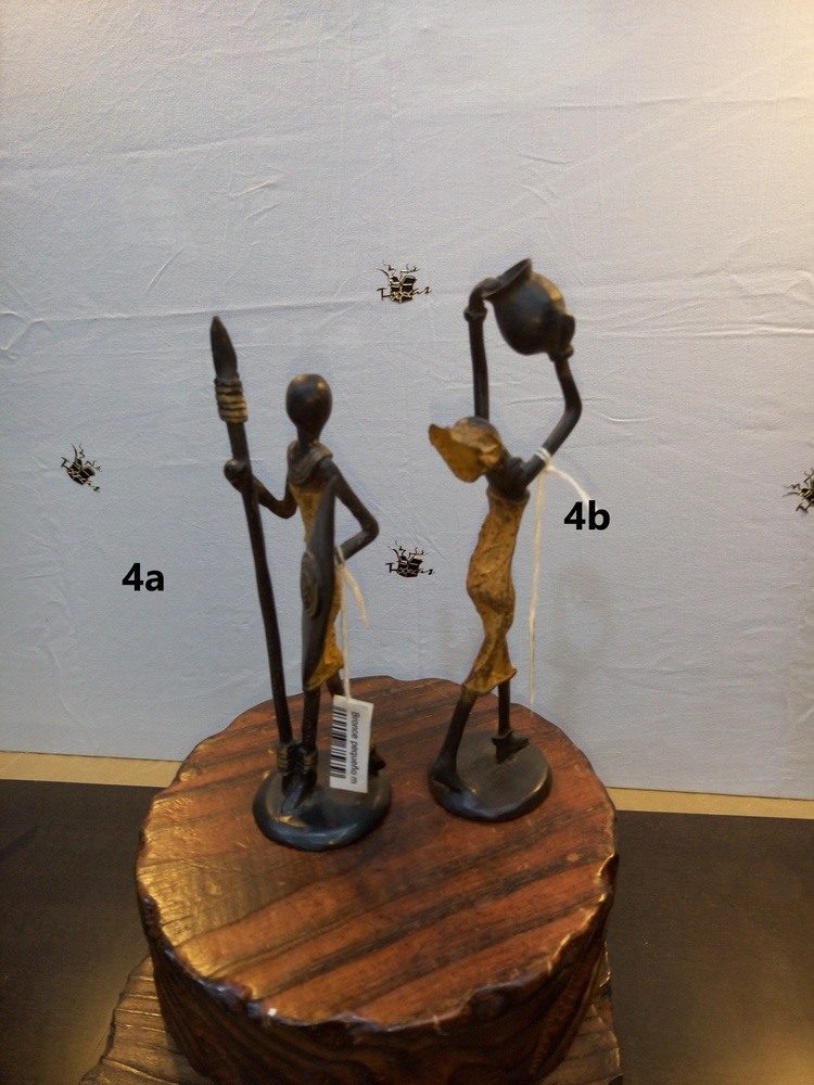 african bronzes - native with spear and shield and woman with raised pitcher