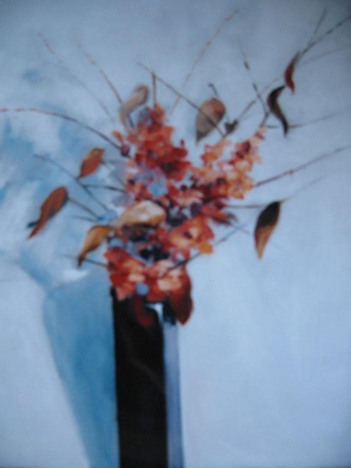 Jarrón con flores otoñales