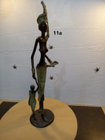 """Bronces Africanos - """"Mujer con niño y sin blusa"""""""
